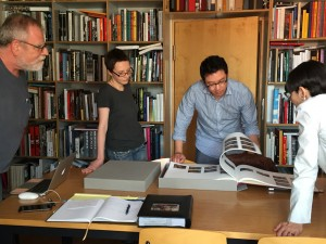 Ken, Maren, Josh and Lunetta looking at recently published book.