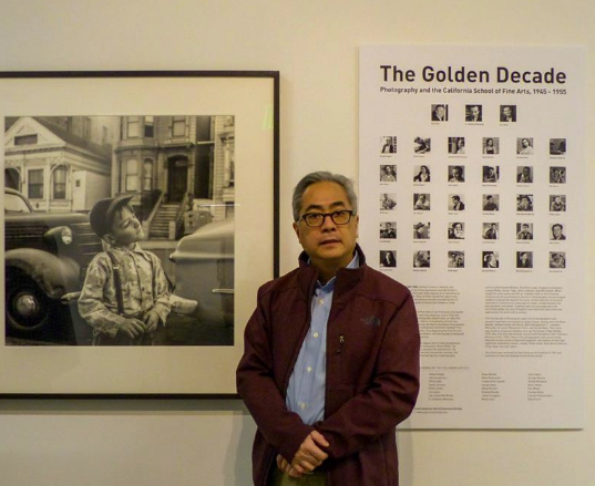 Adam Chin, nephew of Benjamen Chinn, by the Golden Decade poster and book cover photo.